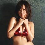 Beautiful gravure idols pink bikini can barely hold her big tits
