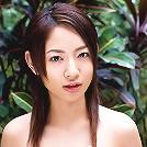 Alluring asian beauty with a perfect body in an orange bikini