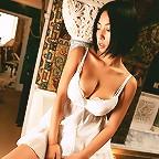 Cute, petite asian model wearing slinky little dresses to tease