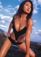 Steamy gravure idol is incredibly sexy in her black bikini