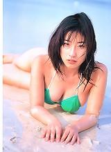 Voluptuous gravure idol in a bikini showing off her big boobs