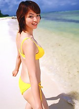 Big breasted asian idol soaks up the rays in her bikini at beach