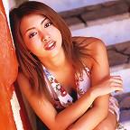 Beautiful short haired gravure idol is stunning in her bikini