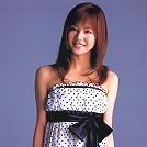 Cute asian girl is flirtatious with her long hair in a dress