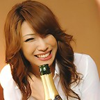 Aya Sakuraba enjoys some champagne and cum on her juicy pussy