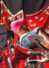 Lulu posing on a motorcycle