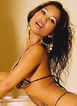 Asian bombshell in a sexy bikini wants to show you something