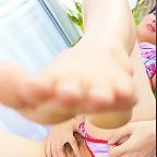 Kieko Kyo gives us a peek at her little pink pussy